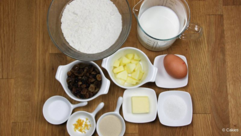 Ingredients for Oliebollen on a wooden surface.