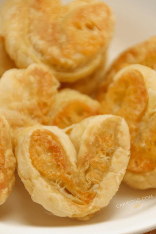Cheese Palmiers are easy to make yourself. All you need is puff pastry, cheese and some egg wash and you can make your own cheese palmiers.