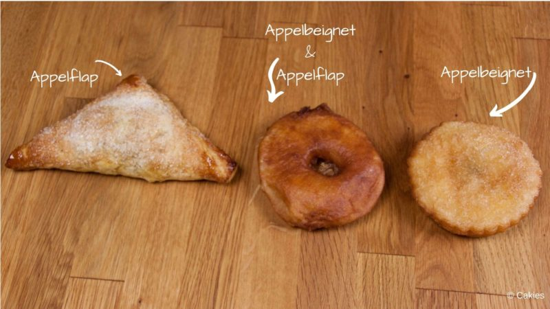 from left to right on a wooden surface: oven baked appelflap made with puff pastry, deep fried dutch apple beignet made with batter, deep fried dutch apple beignet made with puff pastry. With text and an arrow pointing to each pastry stating what it is.