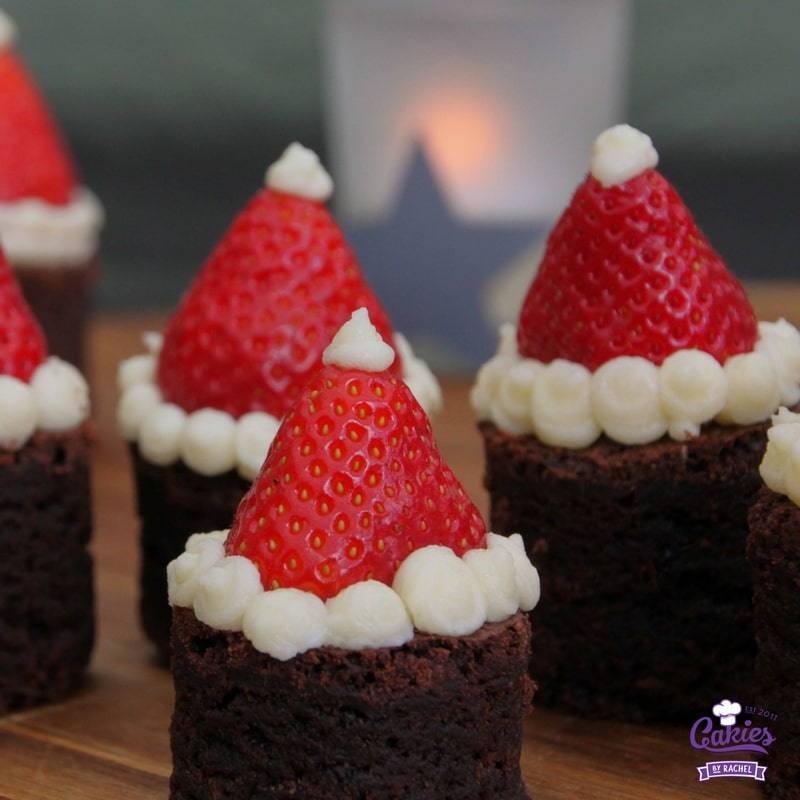 Santa Hat Brownies | These Santa Hat Brownies are super cute and easy to make. A perfect Christmas recipe. Everyone will love these rich brownies topped with strawberries. | http://www.cakieshq.com